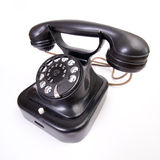 Old-fashioned telephone on the white backing Royalty Free Stock Photography