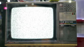 Old fashioned television. Video of old fashioned television set with name '3 system' in uppercase letters and showing noisy wobbly screen indicating low quality stock footage