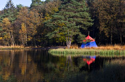 Old fashioned tent in forest Royalty Free Stock Images