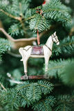 Old fashioned toy horse on Christmas tree Royalty Free Stock Photos