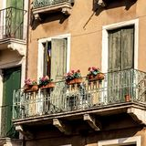 Old fashioned traditional balcony with flowers in Venice, Italy royalty free stock photos