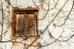 Old fashioned traditional closed wooden window in village Jhong in Nepal, Lower Mustang Region stock photo