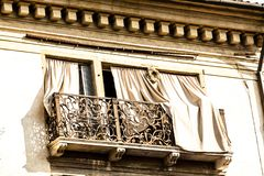 Old fashioned traditional wood window with beautiful balcony in Venice, Italy stock image