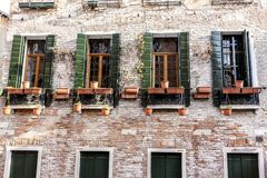 Old fashioned traditional wood windows in Venice, Italy royalty free stock photo