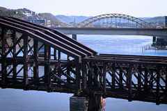 Old-fashioned train bridge. An old steel train bridge crossing a river. Taken in Pittsburgh, PA Stock Photos