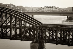 Old-fashioned train bridge. An old steel train bridge crossing a river. Taken in Pittsburgh, PA Royalty Free Stock Image