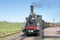 Old fashioned train running in the Netherlands Royalty Free Stock Image