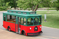 Old fashioned trolley in a park setting Stock Photos