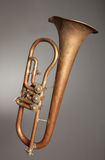 Old-fashioned trumpet. An old trumpet against grey background Royalty Free Stock Photos