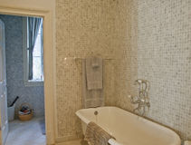 Old Fashioned Tub in Mosaic Tile Bathroom Royalty Free Stock Images