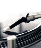 Old fashioned turntable playing a track from black vinyl Royalty Free Stock Images