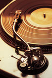 Old fashioned turntable playing a track stock photography