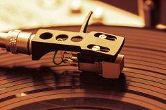 Old fashioned turntable playing a track stock photo