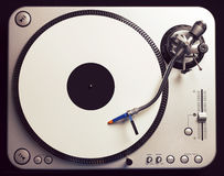 Old fashioned turntable playing a track Royalty Free Stock Photo