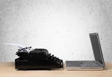Old fashioned typewriter with a modern laptop. Old modern fashioned laptop typewriter work from home mock up Stock Images