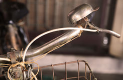 Old-fashioned vintage bike handlebar and bell. (This picture is processed by warn tone for retro style royalty free stock photo
