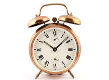 Old-fashioned vintage copper alarm clock. Against white stock images