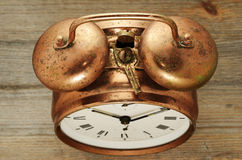 Old-fashioned vintage copper alarm clock Stock Photography