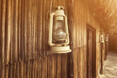 Old fashioned vintage kerosene oil lantern lamp with aged wooden wall Stock Photography