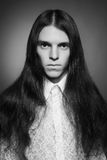 Old fashioned (vintage, retro style) portrait of long-haired man Stock Photos