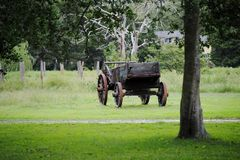 Old fashioned Wagon. An old fashioned wagon in a field Royalty Free Stock Photography