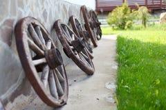 Old-fashioned wagon wheels stock photos