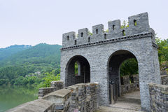 Old-fashioned watchtower on ancient wall with parapets Royalty Free Stock Photo