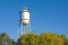 Old-fashioned water tower Stock Images