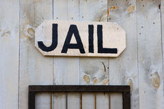 An old-fashioned Western jail sign Stock Photography