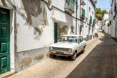 Old-fashioned white car ina village Royalty Free Stock Photo