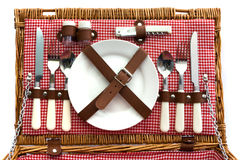 Old fashioned wicker picnic basket with cutlery. Old fasioned wicker picnic basket with cutlery Stock Photo