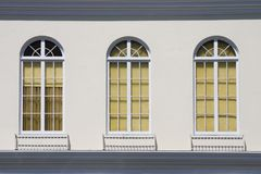 Old Fashioned Windows. Three paned glass windows on the side of an old building in Oakland, CA Royalty Free Stock Image