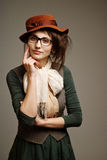 Old-fashioned woman. An image of a young old-fashioned woman in big glasses royalty free stock photos