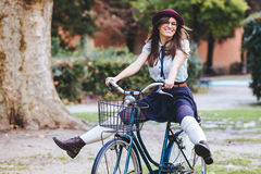 Old Fashioned Woman. Riding Bicycle at Park royalty free stock photography