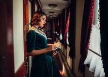 Old-fashioned woman travels, retro train Royalty Free Stock Photo