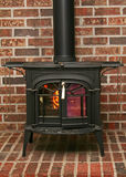 Old fashioned wood burning stove. On a brick base stock photo