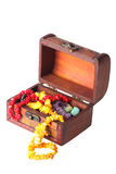 Old-fashioned wooden chest full of jewelry Stock Photos