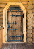Old-fashioned wooden door Stock Photography
