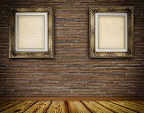 Old-fashioned wooden frame on brick wall. Stock Photo