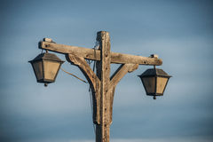 Old fashioned wooden street light with two lamps Stock Photo