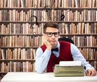 Old fashioned writer with question marks over head Stock Photography