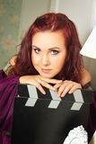 Old-fasioned actress in purple Stock Image
