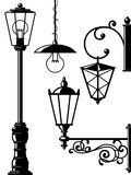 Old-fasioned lanterns. Silhouettes of retro lanterns (street lamps Stock Photo