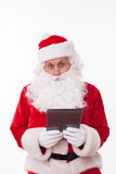 Old Father Christmas is gifting modern technology Royalty Free Stock Photography