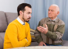 Old father and son serious talk stock image