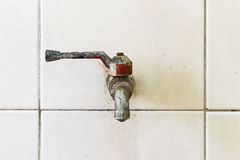 Old faucet. In the old bathroom Stock Photos
