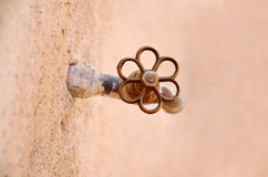 Old faucet handle Royalty Free Stock Photo