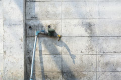 Old faucet on old peeling paint brick wall grunge and dirty Stock Images
