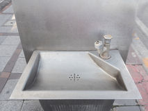 Old faucet with sink in public park Royalty Free Stock Photo