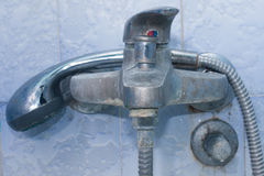 Old faucet on the wall in the bathroom Stock Photography